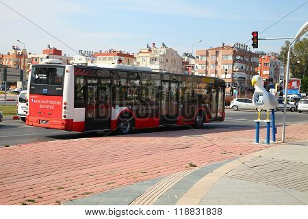 Antalya, Turkey - June 7, 2015: City Bus Standing In Front Of A Traffic Light At The Crossroads