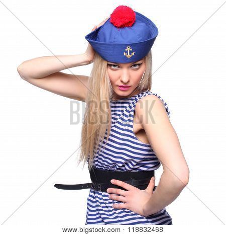 Young blond female sailor posing in her uniform and looking at the camera isolated on white background