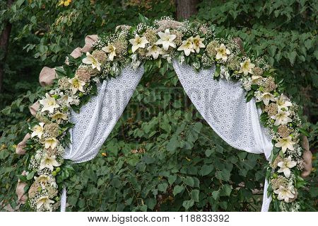Wedding archway with flowers arranged in park  for a wedding ceremony