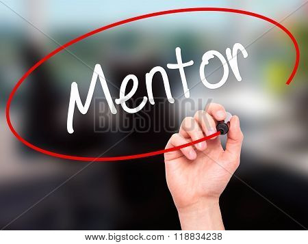 Man Hand Writing Mentor  With Black Marker On Visual Screen