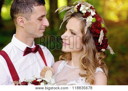Romantic wedding couple looking at each other