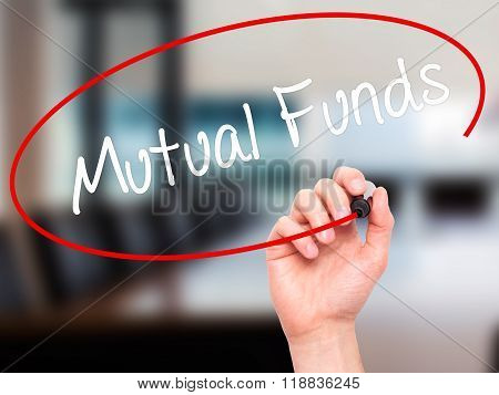Man Hand Writing Mutual Funds  With Black Marker On Visual Screen