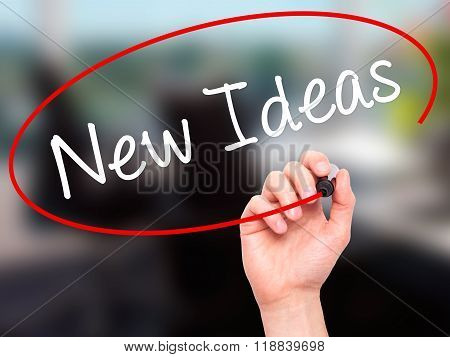 Man Hand Writing New Ideas With Black Marker On Visual Screen