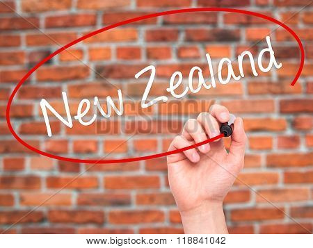 Man Hand Writing  New Zealand With Black Marker On Visual Screen