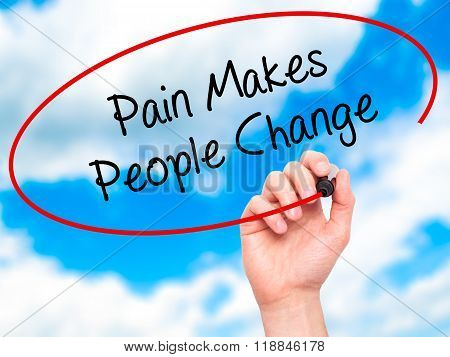 Man Hand Writing Pain Makes People Change  With Black Marker On Visual Screen