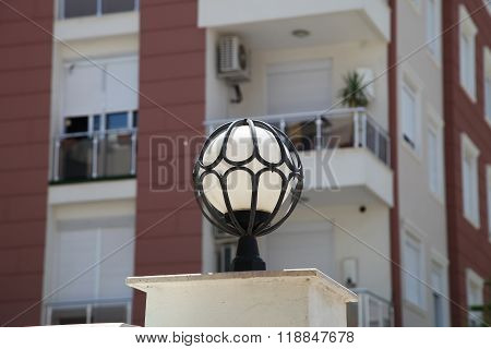 Street Lamp In The Form Of A Ball In The Forged Frame In The Summer Sun