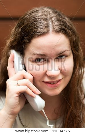 Young Beautiful Woman Speaking By Phone