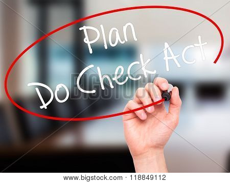 Man Hand Writing Plan Do Check Act  With Black Marker On Visual Screen