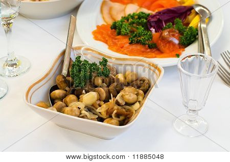 Plate With Vinegar Pickled Mushrooms On Table, Cutlery For Dinner, Small Jigger, Selective Focus.