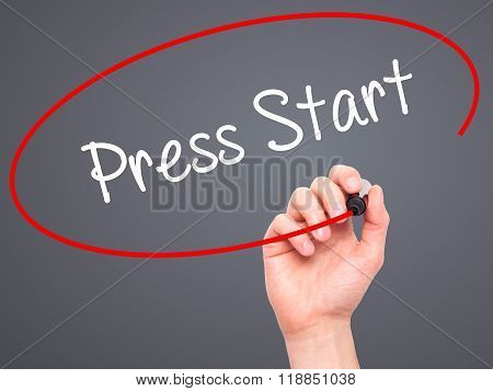 Man Hand Writing Press Start With Black Marker On Visual Screen