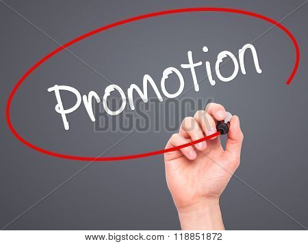 Man Hand Writing Promotion With Black Marker On Visual Screen