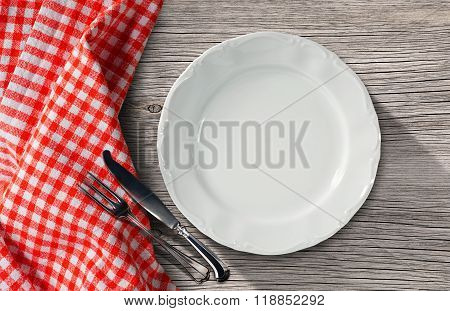Plate And Cutlery On A Table With Tablecloth