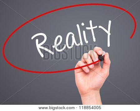 Man Hand Writing  Reality With Black Marker On Visual Screen