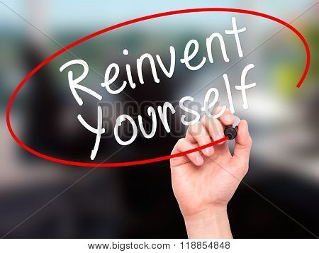 Man Hand Writing Reinvent Yourself With Black Marker On Visual Screen