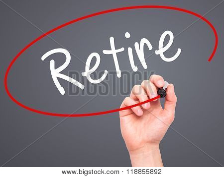 Man Hand Writing Retire With Black Marker On Visual Screen