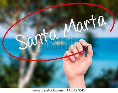 Man Hand Writing Santa Marta With Black Marker On Visual Screen