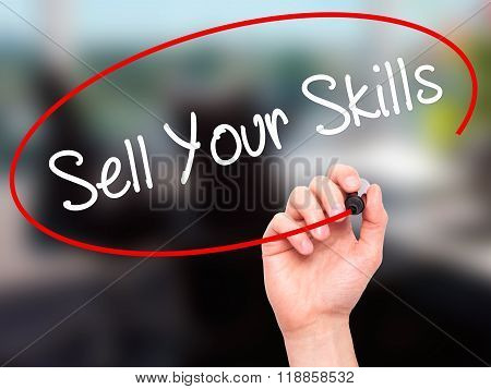 Man Hand Writing Sell Your Skills With Black Marker On Visual Screen