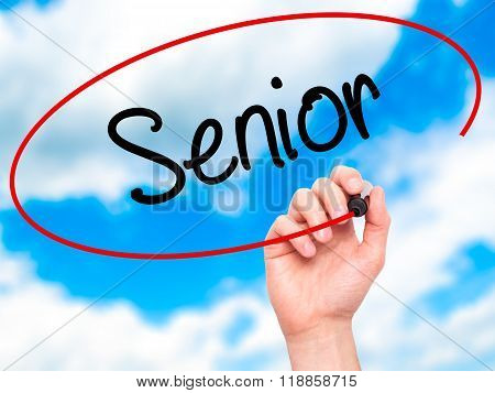 Man Hand Writing Senior With Black Marker On Visual Screen