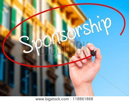 Man Hand Writing Sponsorship  With Black Marker On Visual Screen