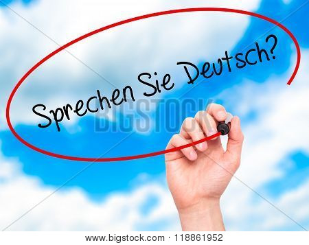 "Man Hand Writing ""sprechen Sie Deutsch?"" (in German - Do You Speak German?) With Black Mar"