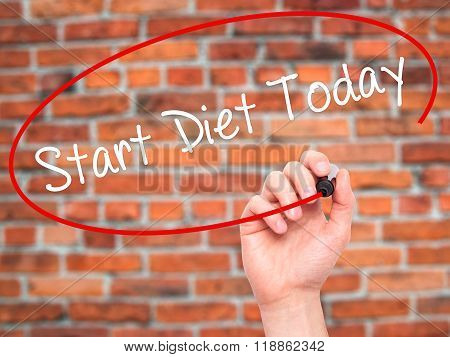 Man Hand Writing Start Diet Today  With Black Marker On Visual Screen