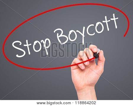 Man Hand Writing  Stop Boycott With Black Marker On Visual Screen