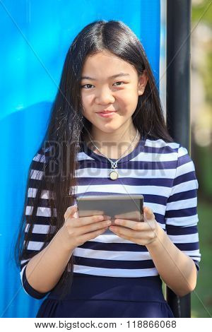 Asian Girl And Computer Tablet In Hand Standing With Toothy Smiling Face Use For People And Internet