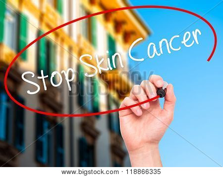 Man Hand Writing Stop Skin Cancer With Black Marker On Visual Screen