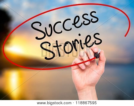 Man Hand Writing Success Stories With Black Marker On Visual Screen