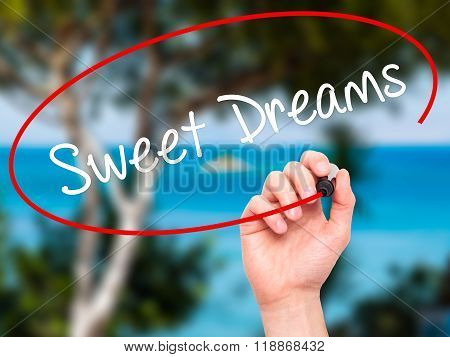 Man Hand Writing Sweet Dreams With Black Marker On Visual Screen