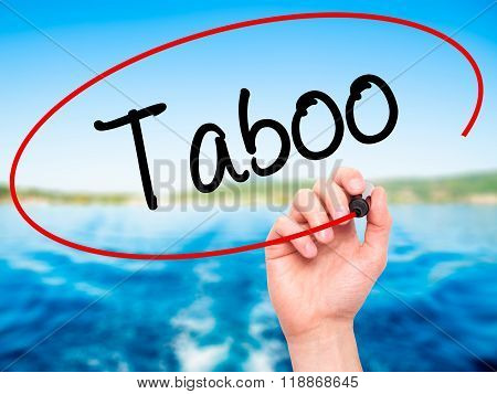 Man Hand Writing Taboo With Black Marker On Visual Screen