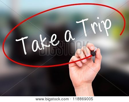 Man Hand Writing Take A Trip With Black Marker On Visual Screen