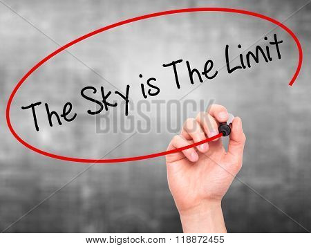 Man Hand Writing The Sky Is The Limit  With Black Marker On Visual Screen