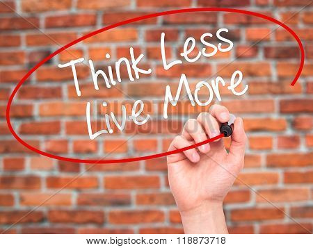 Man Hand Writing Think Less Live More With Black Marker On Visual Screen