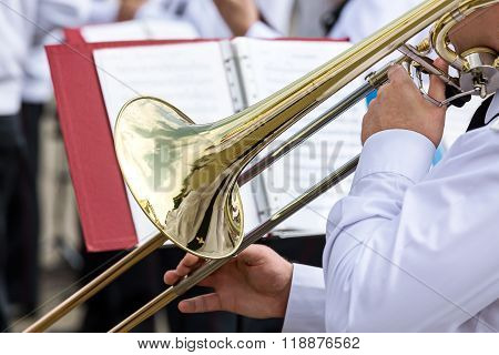 Musician Of Military Orchestra Plays His Trombone