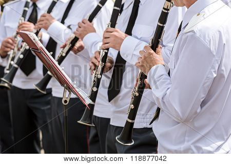 Group Of Musicians In The Military Orchestra Plays Clarinets