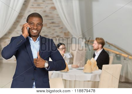 Businessman speaking over mobile phone