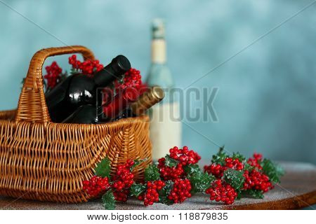 Christmas wine in basket on table