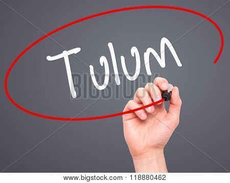 Man Hand Writing Tulum With Black Marker On Visual Screen