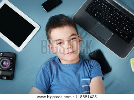 boy on blue blanket background with laptop