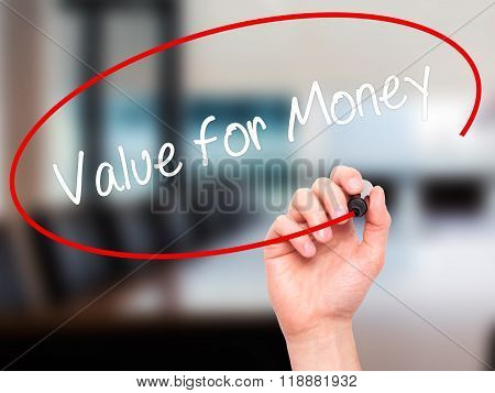 Man Hand Writing Value For Money With Black Marker On Visual Screen