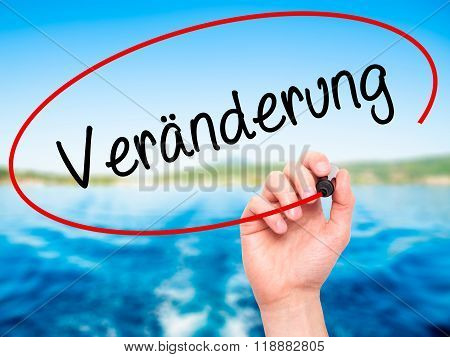 Man Hand Writing Veranderung  (change In German) With Black Marker On Visual Screen