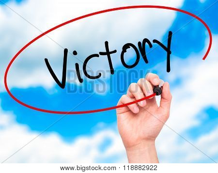 Man Hand Writing Victory  With Black Marker On Visual Screen
