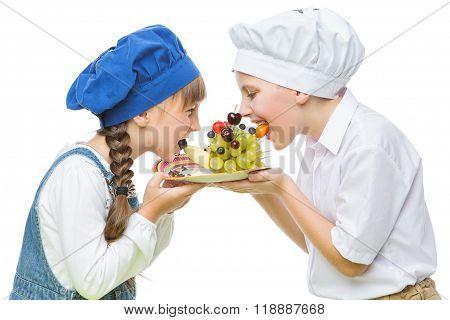 Children holding hedgehog shape fruit snack