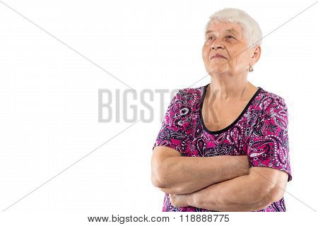 Elderly lady with arms crossed looking up
