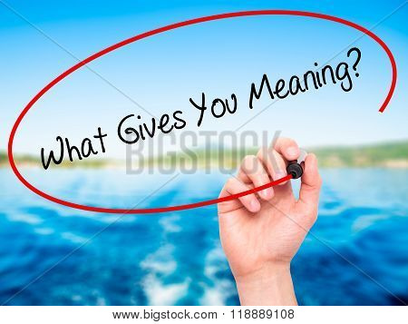 Man Hand Writing What Gives You Meaning? With Black Marker On Visual Screen