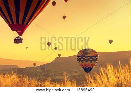 Hot air balloons flying over spectacular Cappadocia