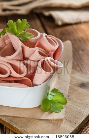 Sliced Mortadella On Wooden Background