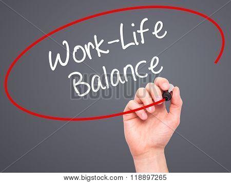 Man Hand Writing Work-life Balance With Black Marker On Visual Screen