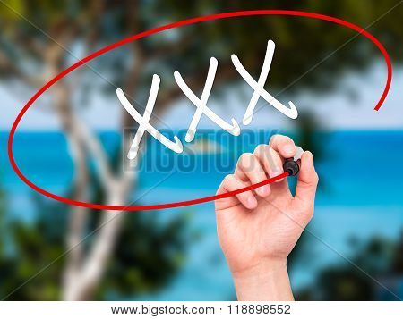 Man Hand Writing Xxx With Black Marker On Visual Screen